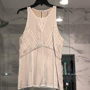 Peplum style sleeveless blouse